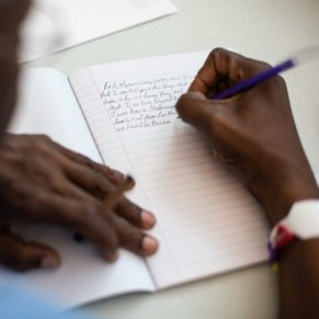 06/26/17 -- Boston, MA -- Larry Bates works on a piece of writing during a creative writing group for the homeless at the Barbara McInnis House on June 26, 2017, in Boston, Massachusetts. (Kayana Szymczak for STAT)